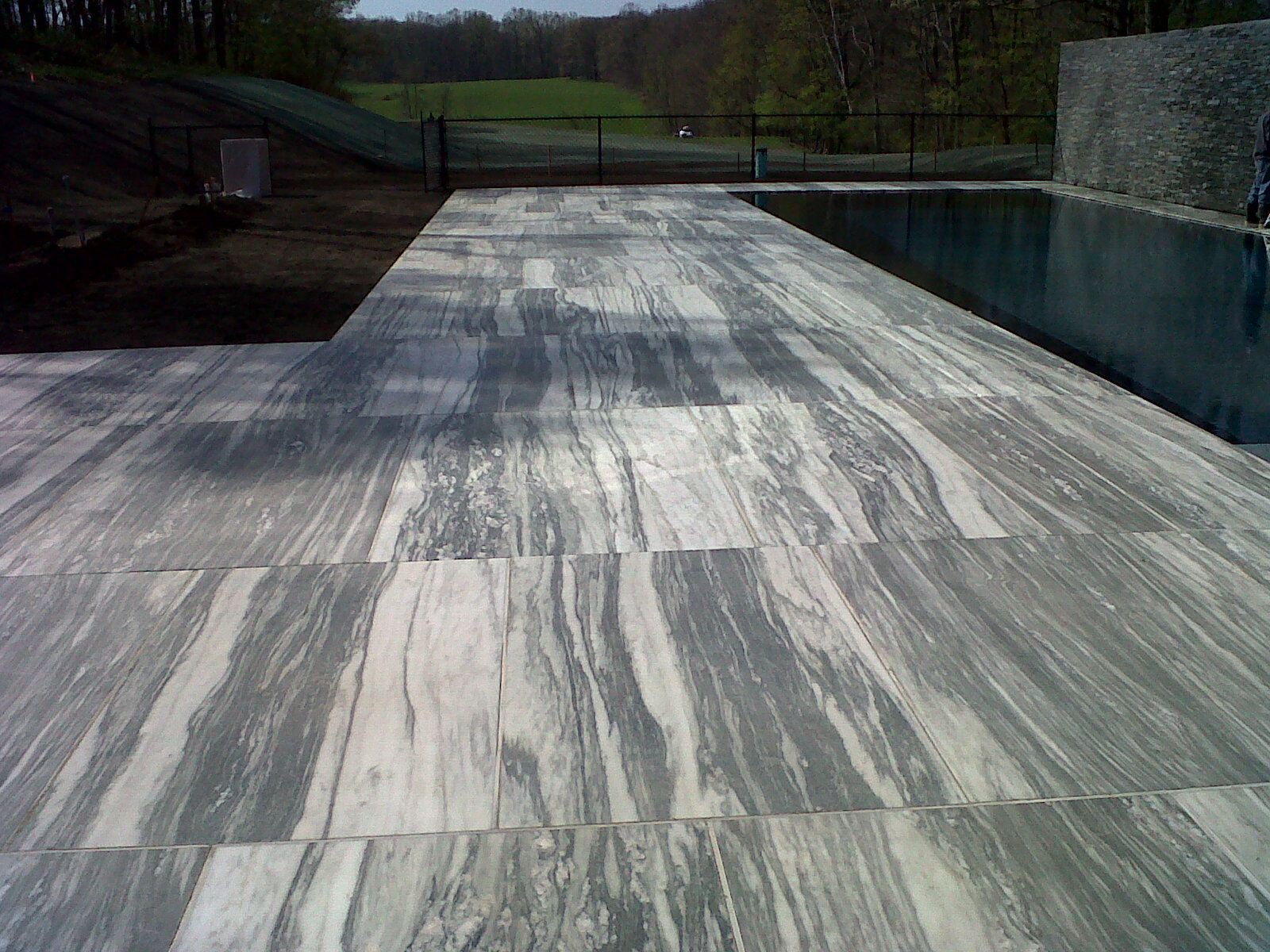 pool deck- vermont marble, honed finish |