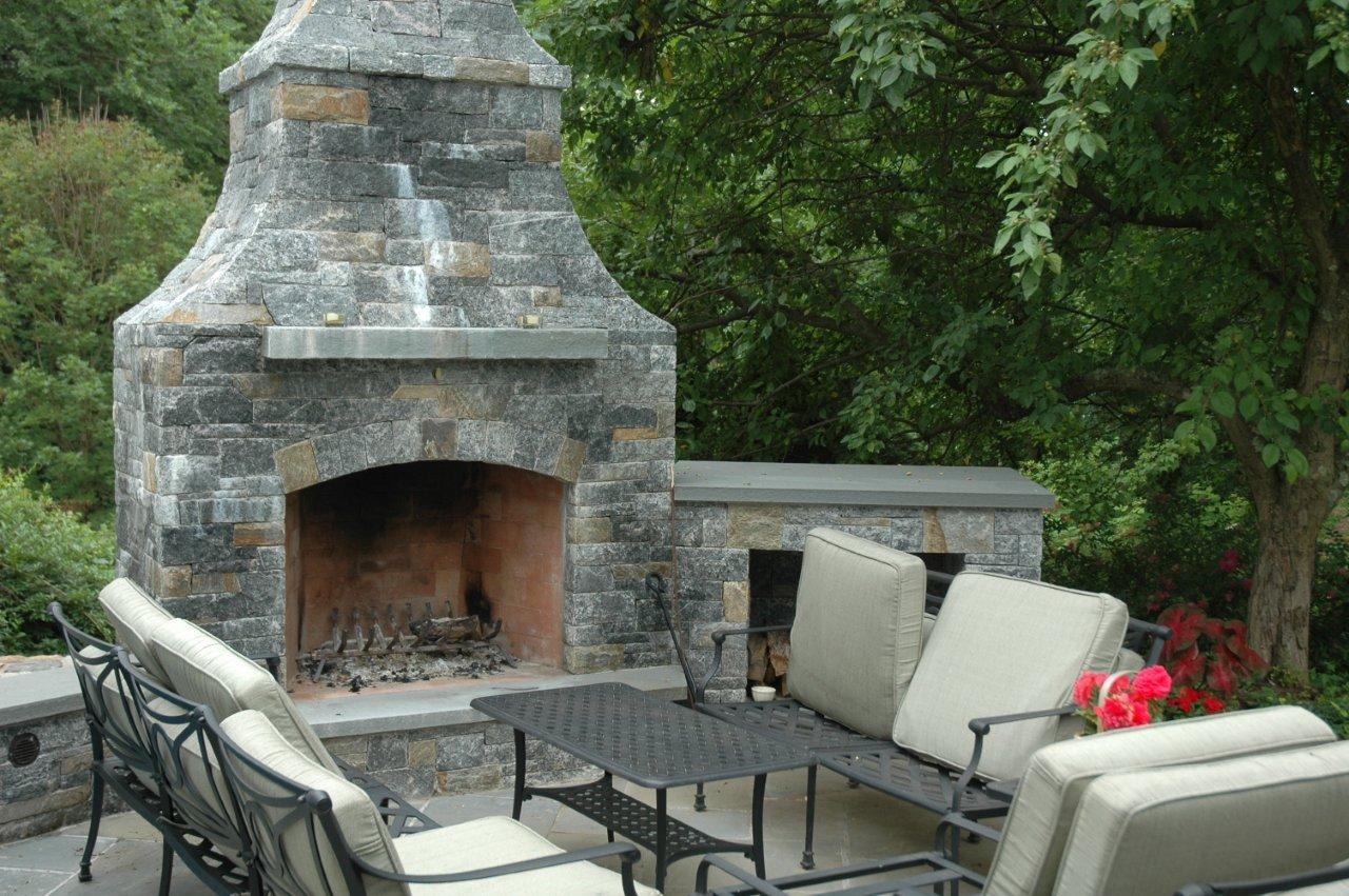 outdoor fireplace with granite square and rectangled stone veneer